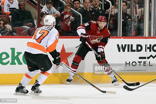 Jiri Sekac of the Arizona Coyotes looks to pass the puck around Andrew MacDonald of the Philadelphia Flyers during the second period at Gila River...