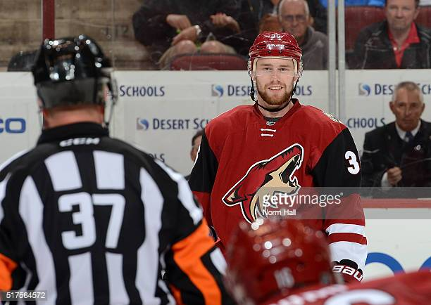 Jiri Sekac of the Arizona Coyotes talks with referee Kyle Rehman prior to a faceoff against the Edmonton Oilers at Gila River Arena on March 22 2016...