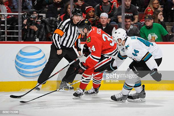 Jiri Sekac of the Chicago Blackhawks and MarcEdouard Vlasic of the San Jose Sharks chase the puck past referee Tom Kowal in the second period of the...