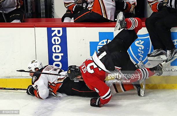 Jiri Sekac of the Chicago Blackhawks goes airborne after collding with Kevin Bieksa of the Anaheim Ducks at the United Center on February 13 2016 in...
