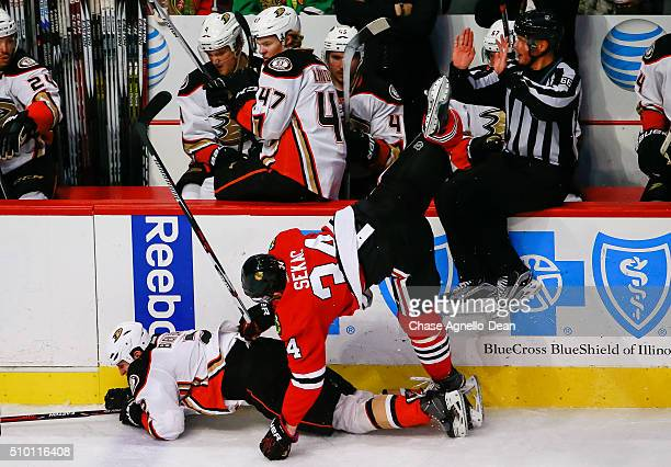 Jiri Sekac of the Chicago Blackhawks hits Kevin Bieksa of the Anaheim Ducks in the third period of the NHL game at the United Center on February 13...