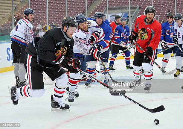 Jiri Sekac of the Chicago Blackhawks looks to block a pass as the Blackhawks scrimmage with the Wounded Warriors during practice day at the 2016...