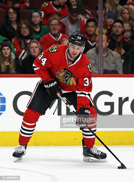 Jiri Sekac of the Chicago Blackhawks looks to pass against the Dallas Stars at the United Center on February 11 2016 in Chicago Illinois The Stars...