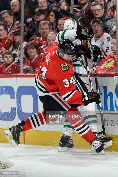 Jiri Sekac of the Chicago Blackhawks works to get the puck against Johnny Oduya of the Dallas Stars in the first period of the NHL game at the United...