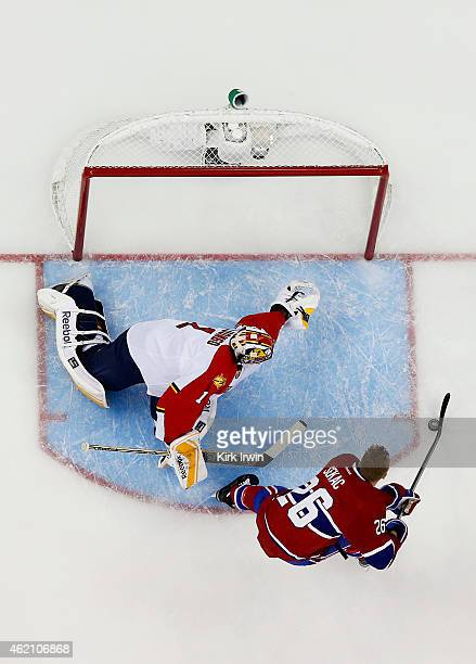 Jiri Sekac of the Montreal Canadiens and Team Foligno takes a shot on Roberto Luongo of the Florida Panthers and Team Toews during the Discover NHL...