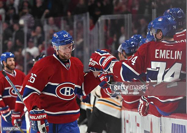 Jiri Sekac of the Montreal Canadiens celebrates with the bench after scoring a goal against the Boston Bruins in the NHL game at the Bell Centre on...