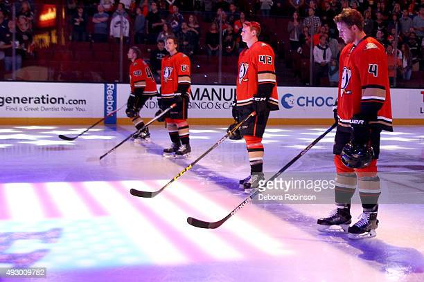 Jiri Sekac Rickard Rakell Josh Manson and Cam Fowler of the Anaheim Ducks line up before the start of their game against the Colorado Avalanche on...