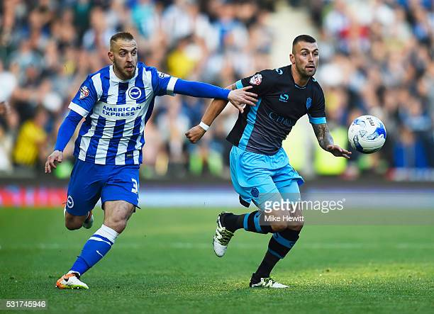 Jiri Skalak of Brighton and Hove Albion and Jack Hunt of Sheffield Wednesday chase the ball during the Sky Bet Championship Play Off semi final...
