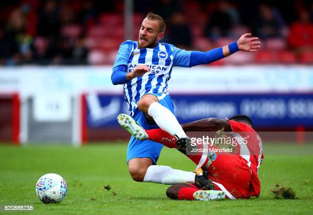 Jiri Skalak of Brighton is tackled by Andre Blackman of Crawley during the Pre Season Friendly match between Crawley Town and Brighton Hove Albion at...