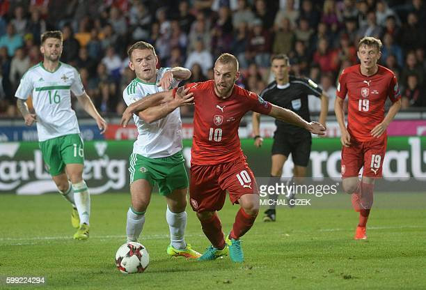 Jiri Skalak of Czech Republic and Lee Hodson of Northern Ireland vie for the ball during the World Cup 2018 football qualification match between...