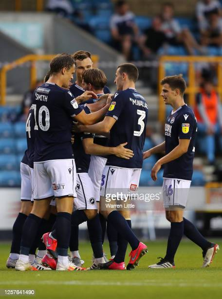 Jiri Skalak of Millwall is congratulated after scoring his teams third goal during the Sky Bet Championship match between Millwall and Huddersfield...