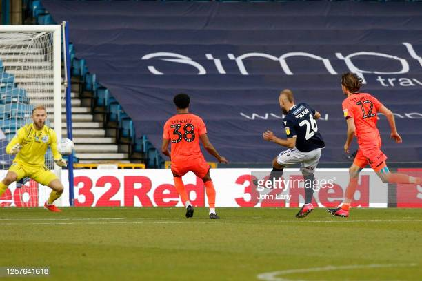 Jiri Skalak scores during the Sky Bet Championship match between Millwall and Huddersfield Town at The Den on July 22 2020 in London England Football...