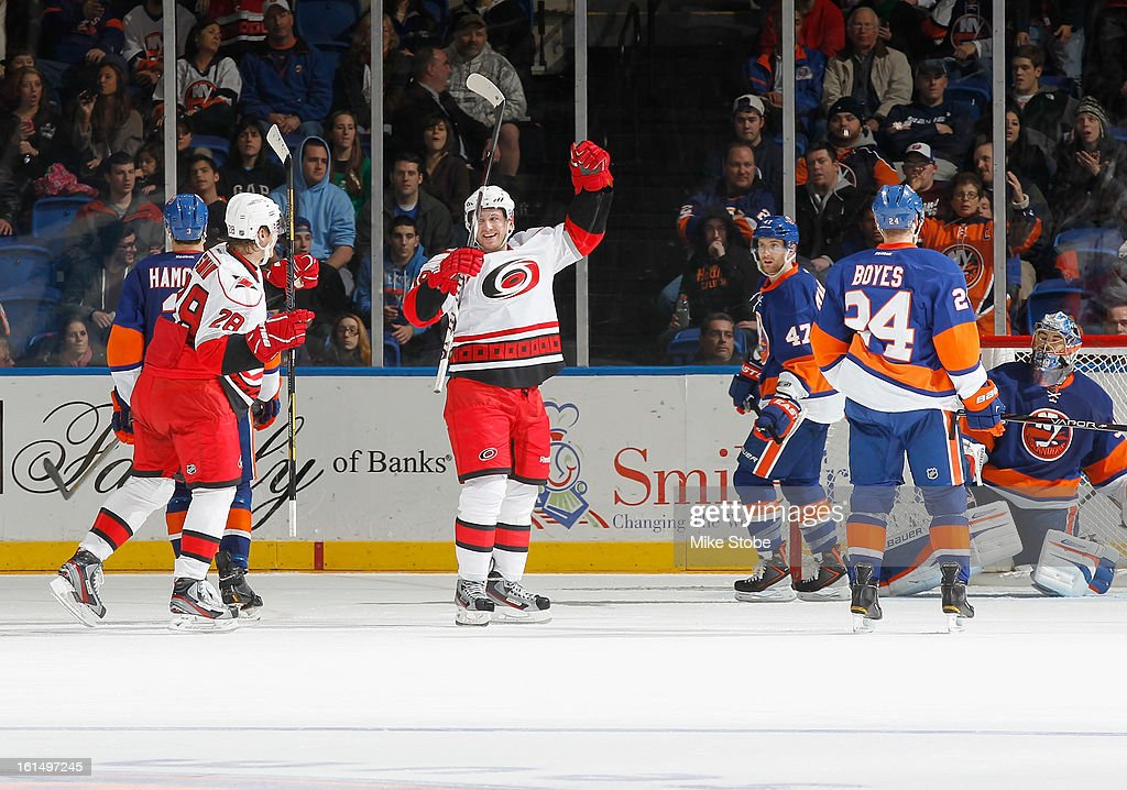 Jiri Tlusty #19 of the Carolina Hurricanes celebrates his third period goal with teammate Alexander Semin #28 during the game against the New York Islanders at Nassau Veterans Memorial Coliseum on February 11, 2013 in Uniondale, New York. The Hurricanes defeated the Islanders 6-4.