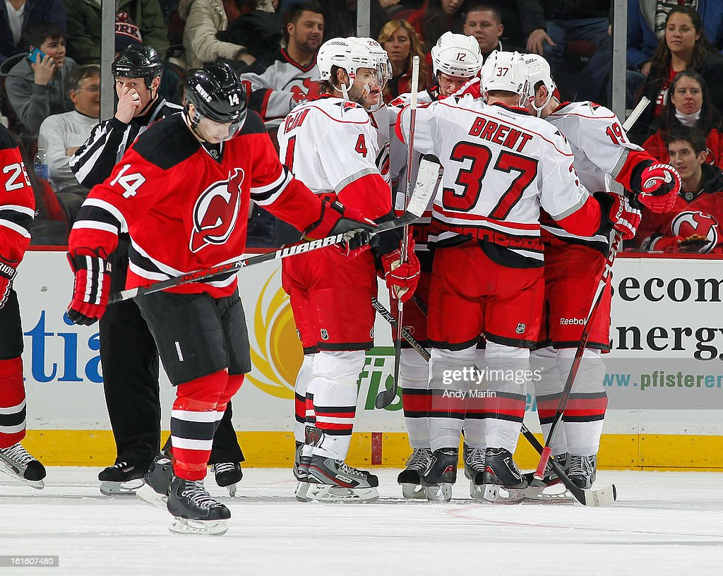 Jiri Tlusty #19 (R) of the Carolina Hurricanes celebrates with his teammates after scoring the game winning goal as Adam Henrique #14 of the New Jersey Devils skates away during the game at the Prudential Center on February 12, 2013 in Newark, New Jersey. The Hurricanes defeated the Devils 4-2.