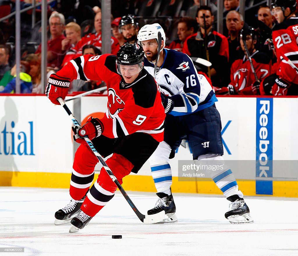 Jiri Tlusty #9 of the New Jersey Devils plays the puck against the Winnipeg Jets during the game at the Prudential Center on October 9, 2015 in Newark, New Jersey.The Jets defeated the Devils 3-1.