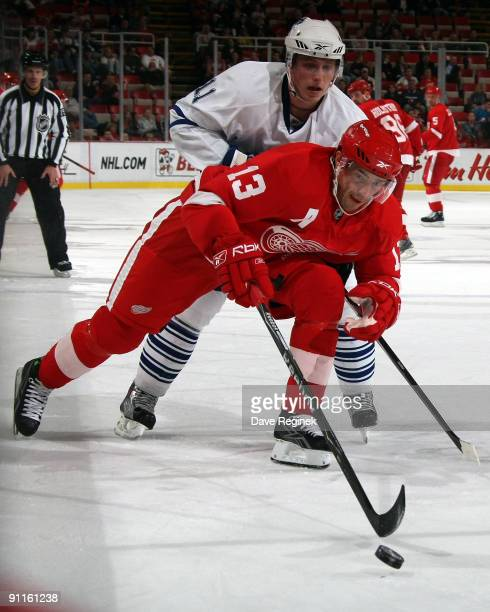 Jiri Tlusty of the Toronto Maple Leafs chases Pavel Datsyuk of the Detroit Red Wings during a NHL preseason game at Joe Louis Arena on September 25...