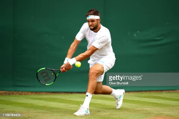 Jiri Vesely of Czech Republic plays a backhand in his Men's Singles second round match against Pablo Cuevas of Uruguay during Day three of The...
