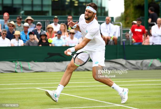 Jiri Vesely of Czech Republic plays a forehand in his Men's Singles second round match against Pablo Cuevas of Uruguay during Day three of The...