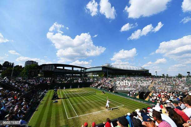 Jiri Vesely of Czech Republic serves against Fabio Fognini of Italy during their Men's Singles third round match on day six of the Wimbledon Lawn...