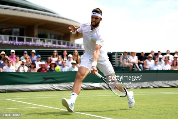 Jiri Vesely of The Czech Republic plays a forehand in his Men's Singles third round match against Benoit Paire of France during Day five of The...