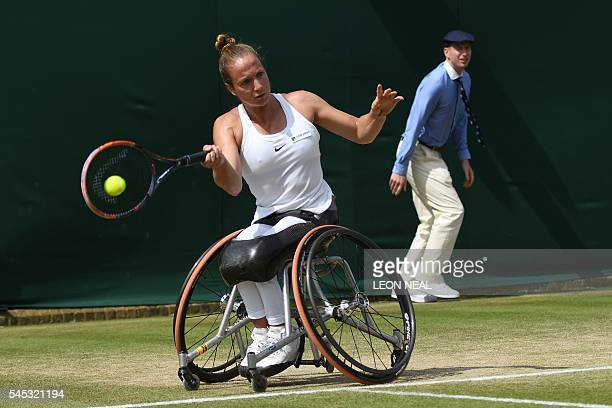 Jiske Griffioen of the Netherlands plays Germany's Sabine Ellerbrock in the women's singles wheelchair event on the eleventh day of the 2016...
