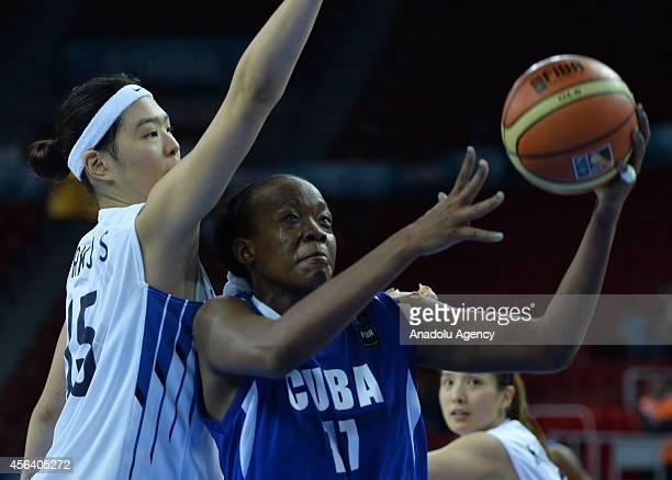 Jisu Park of Korea in action against Marlen Cepeda of Cuba during the 2014 FIBA World Championship For Women Group C basketball match between Korea...