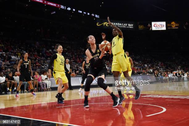 JiSu Park of the Las Vegas Aces handles the ball against Natasha Howard of the Seattle Storm in a WNBA game on May 27 2018 at the Mandalay Bay Events...