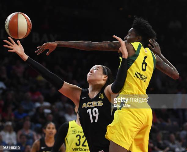 JiSu Park of the Las Vegas Aces loses the ball out of bounds under pressure from Natasha Howard of the Seattle Storm during the Aces' inaugural...
