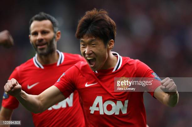 JiSung Park of Manchester United celebrates after scoring his goal during the Barclays Premier League match between Manchester United and Arsenal at...
