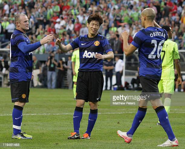 Ji-Sung Park of Manchester United celebrates scoring their fifth goal during the pre-season friendly match between Seattle Sounders and Manchester...