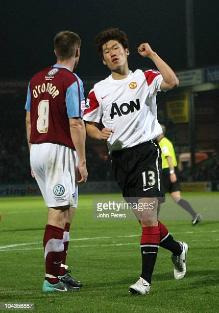 Ji-Sung Park of Manchester United celebrates scoring their fourth goal during the Carling Cup Third Round match between Scunthorpe United and...