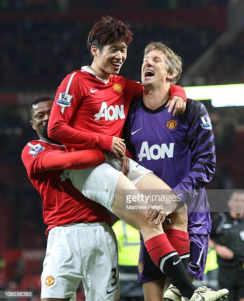 JiSung Park of Manchester United celebrates scoring their second goal with Patrice Evra and Edwin van der Sar during the Barclays Premier League...