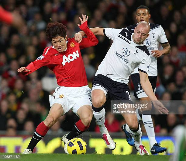 JiSung Park of Manchester United clashes with Alan Hutton of Tottenham Hotspur during the Barclays Premier League match between Manchester United and...