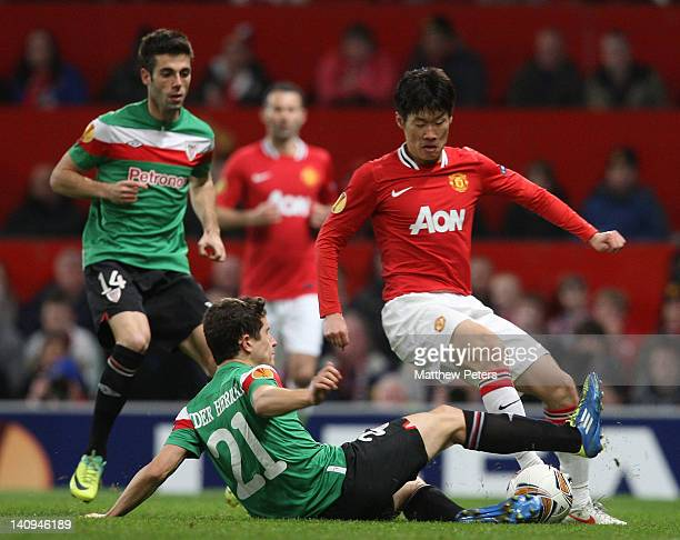 JiSung Park of Manchester United clashes with Ander Herrera of Athletic Club of Bilbao during the UEFA Europa League Round of 16 first leg match...