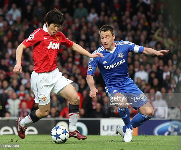 JiSung Park of Manchester United clashes with John Terry of Chelsea during the UEFA Champions League QuarterFinal second leg match between Manchester...