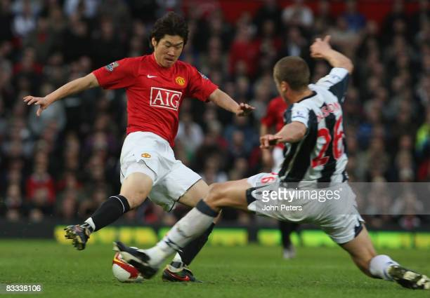 JiSung Park of Manchester United clashes with Jonas Olsson of West Bromwich Albion during the Barclays Premier League match between Manchester United...