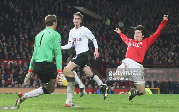 JiSung Park of Manchester United clashes with Mark Schwarzer of Fulham during the Barclays Premier League match between Manchester United and Fulham...