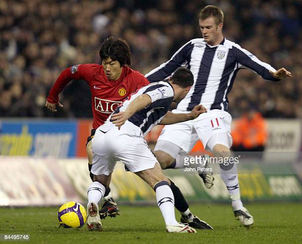 JiSung Park of Manchester United clashes with Paul Robinson of West Bromwich Albion during the Barclays Premier League match between West Bromwich...