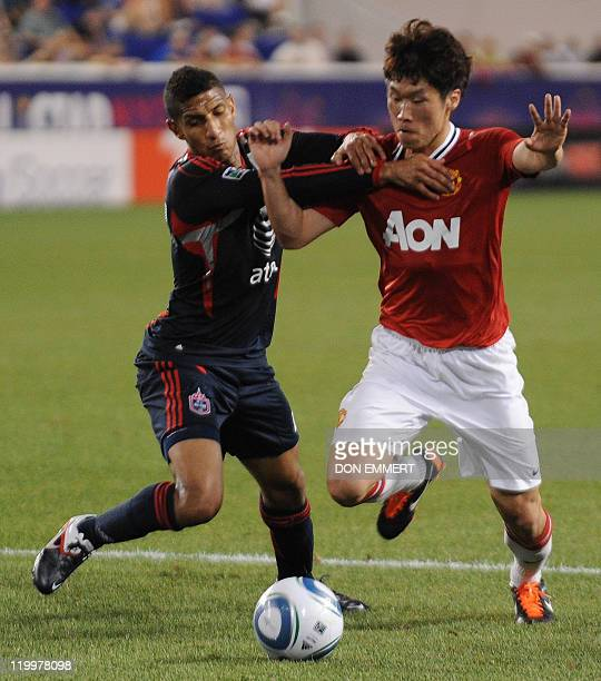 JiSung Park of Manchester United moves the ball before Sean Franklin of the MLS AllStars moments before Park's goal late in the first half during a...