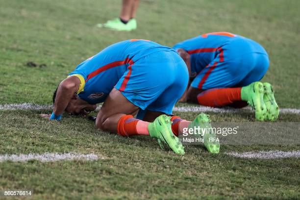 Jitendra Singh and Rahul Kannoly of India react after the FIFA U17 World Cup India 2017 group A match between Ghana and India at Jawaharlal Nehru...