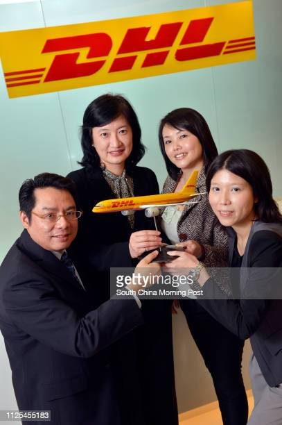 JiuJik feature story on DHL Express Limited Picture of Alan Lee Ngalin tracing manager of customer service division Emmy Man Chinchun senior director...