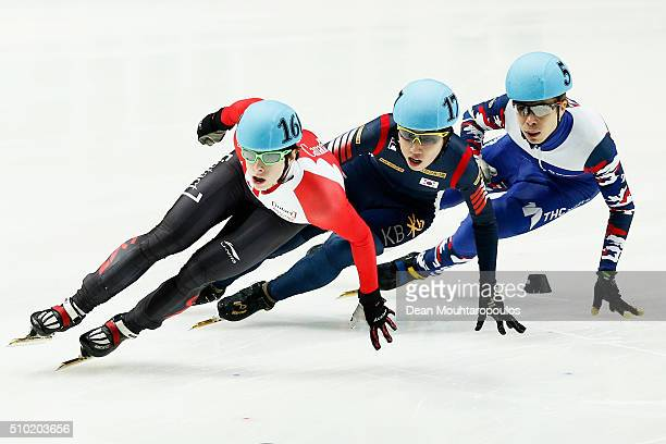 Jiwon Park of South Korea Silver medal Charle Cournoyer of Canada Gold medal and Semen Elistratov of Russia Bronze medal cross the finish line in the...