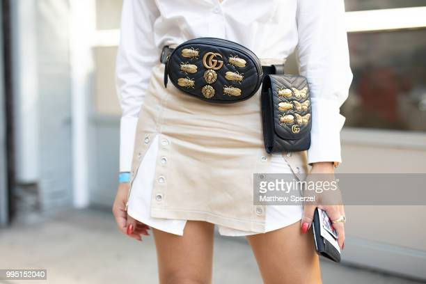 Jixxy Kamchoo is seen on the street attending Men's New York Fashion Week wearing Gucci belt with Alexander wang dress on July 9 2018 in New York City