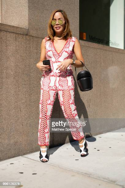 Jixxy Kamchoo is seen on the street attending Men's New York Fashion Week wearing a red and white pantsuit on July 10 2018 in New York City