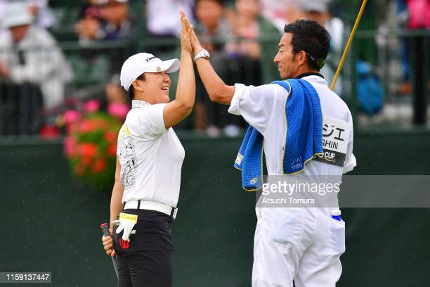 Jiyai Shin of South Korea celebrates winning the tournament with her caddie on the 18th green during the final round of the Earth Mondamin Cup at the...
