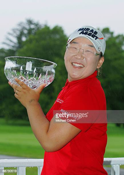 Jiyai Shin of South Korea holds the trophy after winning the Wegmans LPGA at Locust Hill Country Club held on June 28, 2009 in Pittsford, NY.