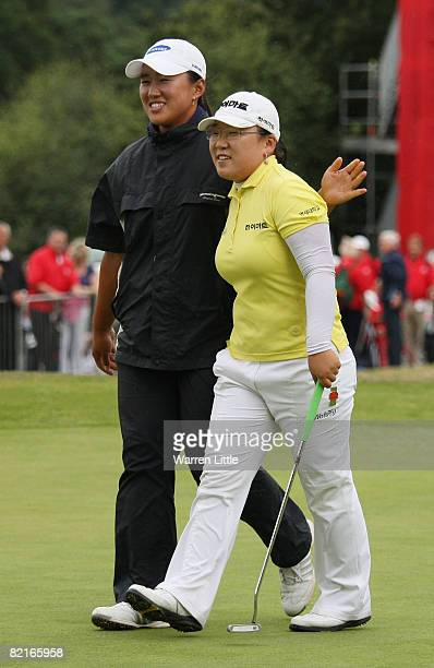JiYai Shin of South Korea is congratulated by fellow Korean golfer Amy Yang after winning the 2008 Ricoh Women's British Open held on the Old Course...