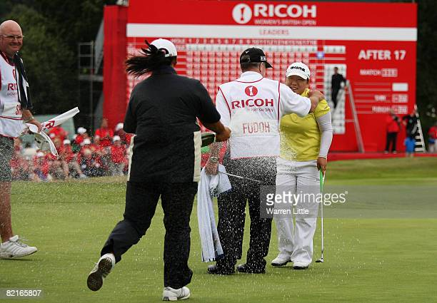 JiYai Shin of South Korea is sprayed with champagne by fellow Korean golfer Amy Yang after winning the 2008 Ricoh Women's British Open held on the...