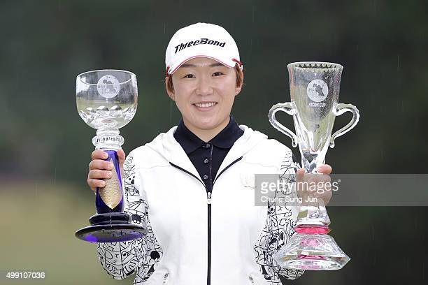 JiYai Shin of South Korea lifts the Championship's trophy and sponsor's Ricoh Cup trophy during a ceremony following the LPGA Tour Championship Ricoh...