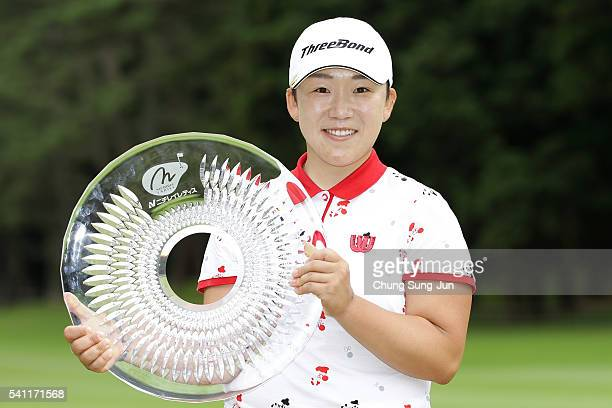 Jiyai Shin of South Korea lifts winner's trophy during a ceremony following the Nichirei Ladies at the Sodegaura Country Club Shinsode Course on June...